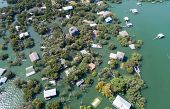 High Above Entire Community Under Water , Focused On A Group Of Houses Half Way Under Water Aerial D poster