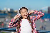 Sing Happiness. Happy Child Wear Headphones. Little Music Fan. Happy Little Girl. Little Girl Listen poster