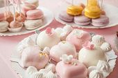 Delicious Sweet Buffet With Cupcakes And Macaroons. Candy Bar For Celebration poster