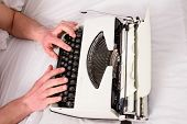 Hands Writer Bed White Bedclothes Working On New Book. Writer Author Used To Old Fashioned Machine I poster