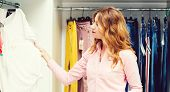 Happy Woman Shopping In Clothing Store. Sale, Fashion, Consumerism And People Concept. Young Woman C poster