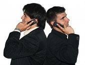 foto of people talking phone  - Two young businessmen talking on their mobile phones - JPG