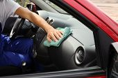 Man Cleaning Automobile Dashboard With Duster In Vehicle. Car Wash Service poster