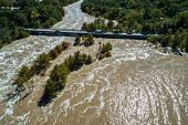 Flood Waters Flow Down The Colorado River In Central Texas As Major Weather Event Unfolds With Flood poster