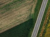 Drone Photography Of Empty Road Through Plain Countryside Landscape, Aerial View Of Two Lane Roadway poster