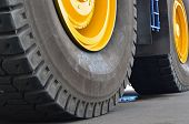 The Protector Of A Large Rubber Wheel. Huge Rubber Tire Career Dump Trucks, Mining Trucks From The T poster