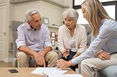 Business agent planning with a retired couple their future investment opportunities. Financial advis poster