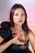 picture of bounce house  - beautiful woman in black dress on sofa with glass of brandy - JPG
