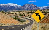 picture of hazard symbol  - A road sign alerts motorists to a curving mountain road in northern New Mexico - JPG