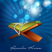 pic of islamic religious holy book  - Open Islamic religious holy book Quran shareef on shiny blue rays background for Ramadan Kareem - JPG