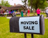 picture of yard sale  - Moving sale in an american weekend on the yard green lawn - JPG