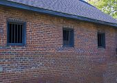 pic of blacksmith shop  - Barred windows on the back of a South Carolina Blacksmith shop built in the early 1800 - JPG