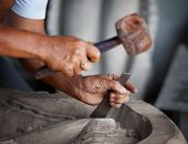 image of woodcarving  - Hands woodcarver while working with the tools - JPG