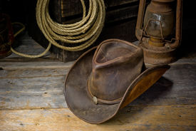 foto of headgear  - an image of a cowboy hat laying on the barn floor - JPG