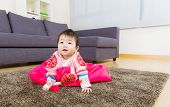 Korean little girl creeping on carpet