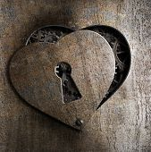 stock photo of keyhole  - metal heart with keyhole - JPG