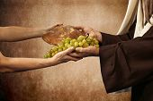 stock photo of bible story  - Jesus gives bread and grapes on beige background - JPG