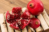 Wooden deco table with beautiful pomegranate arils