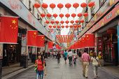 SHENZHEN, CHINA-OCTOBER 05: Shoppers and visitors crowd the Dongmen Pedestrian Street on October 05,