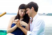 picture of forgiveness  - Woman forgiving smiling husband in vacation in Italy - JPG