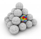 image of aspergers  - A pyramid of balls with puzzle pieces on them and one with colored pieces autism - JPG