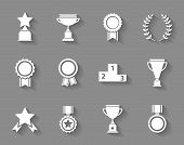 pic of rosettes  - Set of white vector award  success and victory icons with trophies  stars  cups  ribbons  rosettes  medals medallions  wreath and a podium on grey - JPG