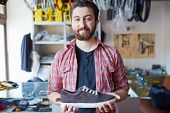 stock photo of single man  - Portrait of a handsome man selling footwear in sports shop - JPG