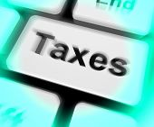 picture of income tax  - Taxes Keyboard Showing Tax Or Taxation Online - JPG