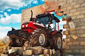 image of overcoming obstacles  - Brand new Tractor powerfull agricultural working machine breaking through wall - JPG