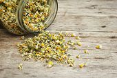 picture of chamomile  - Chamomile tea in the jar on the wooden table - JPG