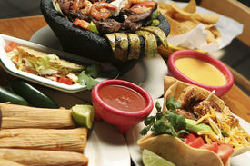 stock photo of mexican food  - Horizontal shot of a variety of Mexican dishes - JPG