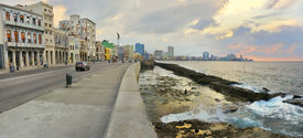 stock photo of malecon  - Panoramic view of Havana bay and city skyline along the waterfront (malecon) at sunset