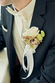 image of boutonniere  - wedding boutonniere on suit of groom - JPG