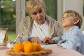 picture of grandma  - Image of grandma and grandson doing homework together - JPG