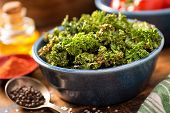pic of kale  - A bowl of crispy delicious baked kale chips.