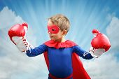 stock photo of crusader  - Superhero child with boxing gloves concept for childhood - JPG