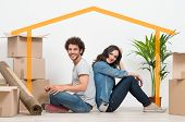 pic of bonding  - Smiling Young Couple Sitting Back To Back After Moving House - JPG
