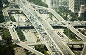 foto of intersection  - Beijing China - August 5 2014: Cars stuck in a traffic jam during a rush hour on a busy road intersection in Beijing China.