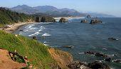 stock photo of cannon  - The rocky and rugged Cannon Beach in Northern Oregon