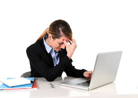 picture of fail job  - young attractive businesswoman working on office computer laptop sitting at office frustrated overworked suffering stress headache depression and work problems - JPG
