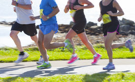 picture of claddagh  - Group of runners compete in the race on coastal road - JPG