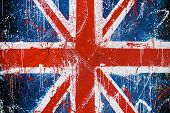 image of wall painting  - Painted concrete wall with graffiti of British flag - JPG