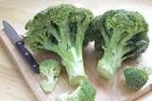 pic of cruciferous  - Broccoli two heads placed on the table with a mat on the floor - JPG