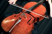 picture of cello  - Musician playing a cello at a classical music concert - JPG