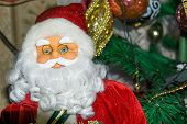 pic of accordion  - Christmas santa toy playing the accordion holiday background - JPG