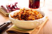 stock photo of sausage  - Braised cabbage with sausages in a bowl - JPG