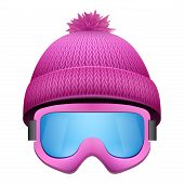 stock photo of knitted cap  - Knitted woolen cap with snow goggles - JPG