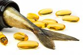 pic of fish  - Fish oil capsules and fish tail in brown jar - JPG