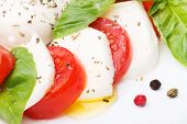 stock photo of basil leaves  - Caprese salad. Mozzarella fresh tomatoes and basil leaves ** Note: Shallow depth of field - JPG