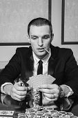 foto of poker hand  - Poker player in the casino with glass of whiskey and cards at the gaming table - JPG